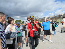 Sami taking our group through the courtyard at the Louvre , Paul S - August 2014