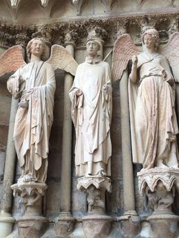 These are angels carved on the outside of the cathedral in Reims. The smiling angel is incredibly famous and is seen in pictures all over. , irishgal76 - July 2014