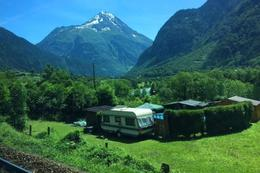 Touring Swiss countryside. Trailer nestled among these spectacular peaks. , Ann Christine - July 2014