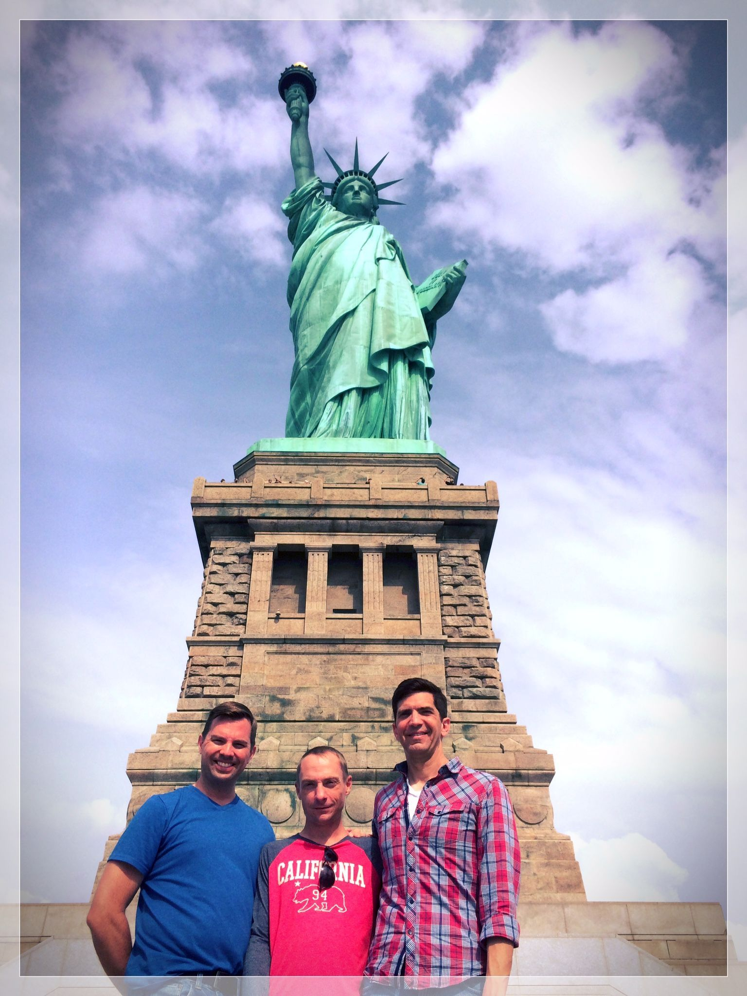Toms photo of us in front of Lady Liberty