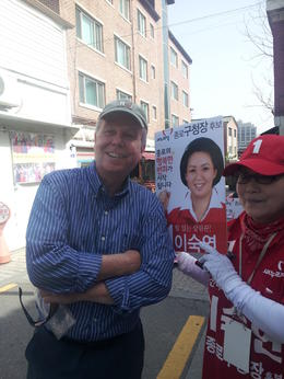 Phil poses in old town Seoul with local #1 supporter to endorse candidate running for mayor or something like that! , Phillip R - June 2014