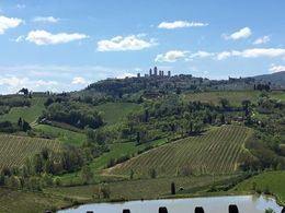 This was the view from our table during lunch at the organic winery and farm looking at the Tuscan countryside and San Gimignano in the background. , Jenna B - April 2016