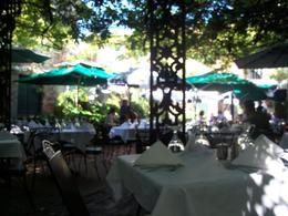 Picture of the courtyard from my table. You sit in the shade, enjoy the food, and listen to amazing jazz! , Jennifer W - October 2011