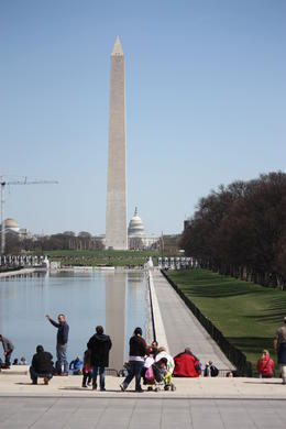 Photo of   Washington Monument with the Capitol Building in the background.