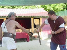 After practicing with wooden swords, my husband trying his hand at the real thing., Dana E - July 2008
