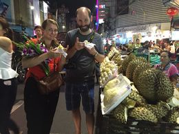 Theresa and James trying durian for the first time. Did not smell bad and was like a custard fruit. , James P - January 2016
