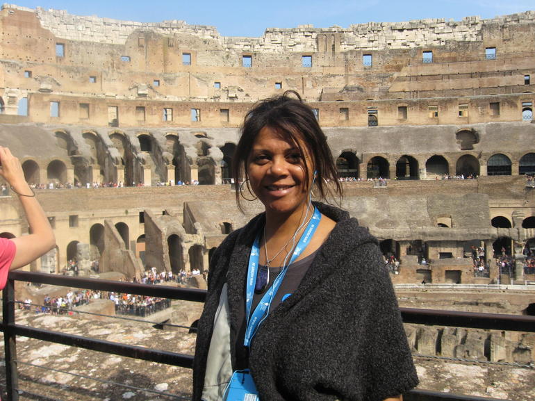 In the foto is myself, Carol G., with the interior of the Colosseum in the background.