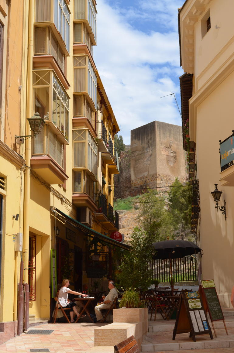 Cafe with Alcazaba in background -