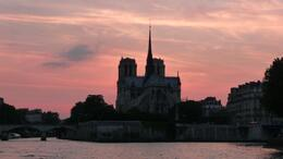 Sun setting on the Seine River Cruise looking back at Notre Dame, Kelly H - August 2010