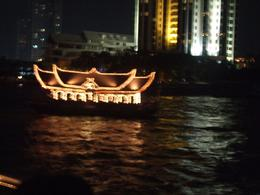 One of the colourful boats that can be seen cruising along the river, providing an excellent opportunity to see Bangkok at night., June H - November 2008