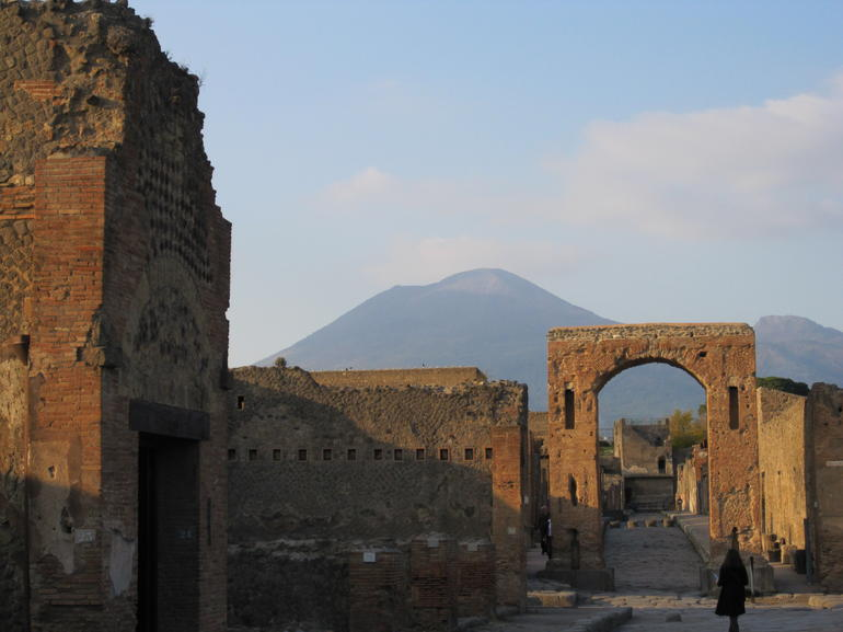 Mt. Vesuvius overlooking Pompeii, which is buried in 79AD.