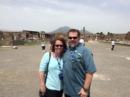 John and Kathy W. in Pompeii with Mt. Vesuvius in the background. , Katherine W - May 2015