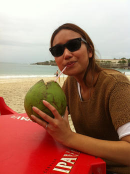 Vina sipping on coconut juice on Copacabana. , Bandit - September 2011