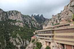 Photo of Barcelona Montserrat Half-Day Small-Group Tour with Optional Cable Car Ride and Skip-the-Line Ticket to La Sagrada Familia Montserrat on a cloudy day