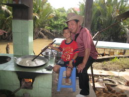 This boy works in the morning in the coconut candy factory and goes to school by noon. , Victor - January 2011