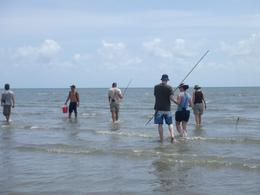 Trying to spear fish on the beach, not very successful! - January 2010