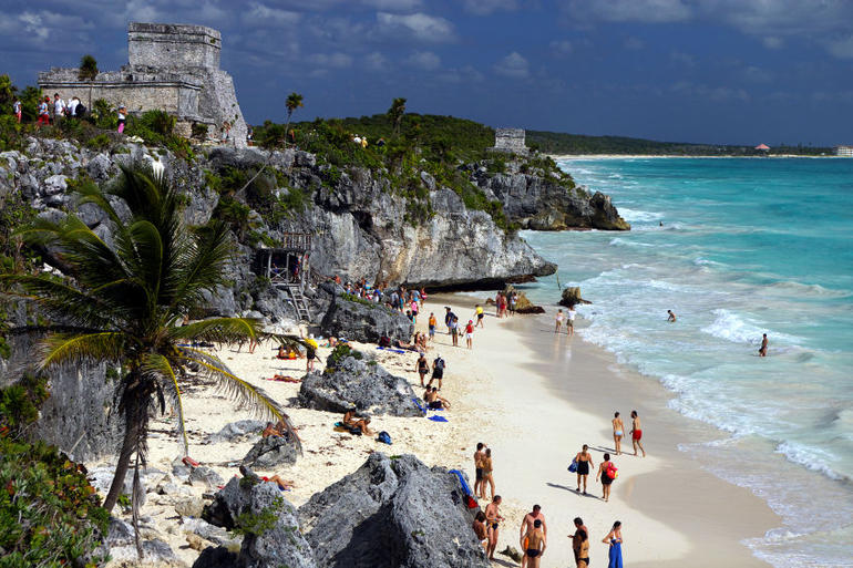 Enjoying the beach in the shadow of the Mayan ruins at Tulum