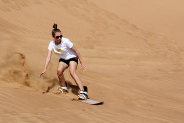 Sandboarding in the Pinnacles Desert
