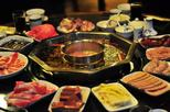 4 hours private Hai Di Lao hot pot dinner experience and nightlife tour
