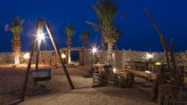 Overnight Desert Camp Experience: Dinner, Emirati Activities and Vintage Land Rover Transport from ...