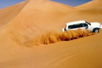 4x4 Abu Dhabi Desert Safar with Camel Ride, Dinner and Belly Dancing Performance
