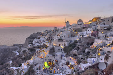 Santorini Sunset Dinner Cruise with Wine Tasting, Volcano Visit and Hot Springs Admission