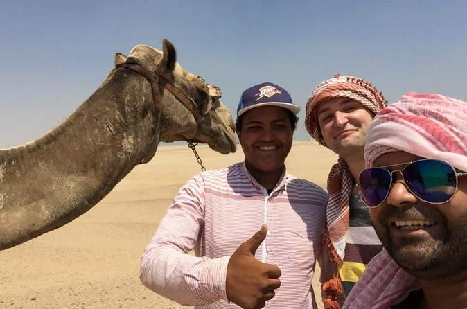 Full day in Giza pyramids with riding camel wearing Arab traditional dress head