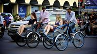 Visiting around the city by Cyclo*