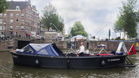 Private Amsterdam Canal Boat Cruise Including Bites & Drinks