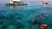 Mactan-Cebu Island Hopping Cruise with Round-Trip Hotel Transport
