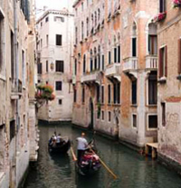 Enjoy a shared gondola ride and serenade on the Venetian waterways