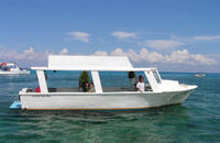 Glass Bottom Boat departing Cozumel