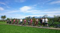 Half-Day Ubud Electric Bike Tour to Tirta Empul Water Temple