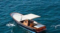 Amalfi Coast private tour by traditional and elegant wooden boats