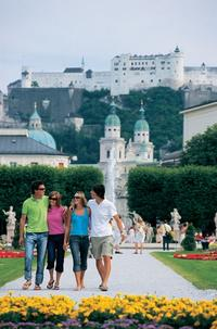 Stroll through the world-famous Mirabell Gardens with Hohensalzburg Fortress in the background