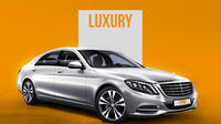 Private Arrival Transfer: Amsterdam Airport to Amsterdam City Center in Luxury Sedan
