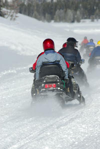 Go on a snowmobiling adventure in the Lyngen Alps*