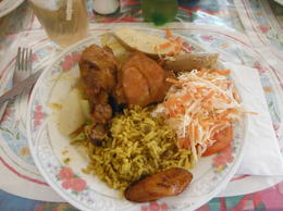 local food - Chicken, Fried plantimes, green bananas, Bread friuit and rice , Carole W - March 2017