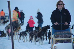 This is me on the dog sled. I was riding here. Later I had a chance to be the Musher sort of. The real musher was actually in control of the dogs. So fun! , Ruth L - July 2016