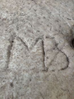 This is Michelangelo's initials carved in a stone in the Vatican museum. , Sharon M - May 2015