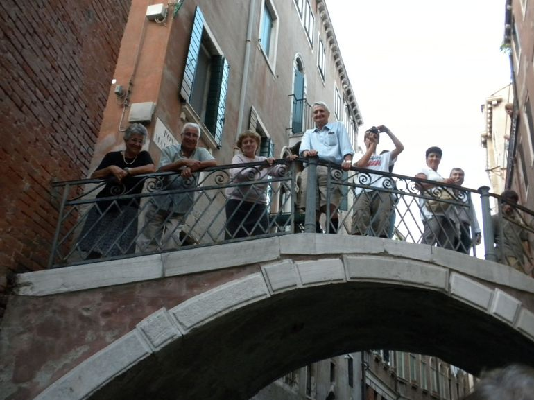 Tourists on Bridge over Canal - Venice