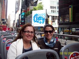 My mom and I on the NYC hop on hop off bus at Times Square., Carolina G - October 2007