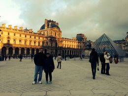 My husband and daughter at the courtyard of the Louvre heading towards the Tuileries gardens. , 2nd one - January 2014