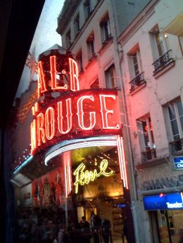 Just pulling up to the Moulin Rouge in our bus, it looked even better when it was dark. Don't even try and get a camera/camera phone out inside the Moulin Rouge, or a scary man will come and take it ... , Rachel B - October 2009