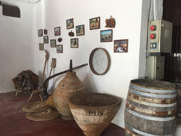 Tools and barrels - clay and oak used to produce wine. Paintings depicting wine making in times past. , Mallory H - September 2016