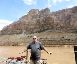 Just flown down to the river via helicoptor through west rim of Grand Canyon, waiting to board the boat , Roger A - September 2015