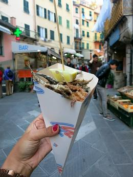 It's a salted mix seafood in a cone, popular snack in Riomaggiore. , Fiona V - November 2014