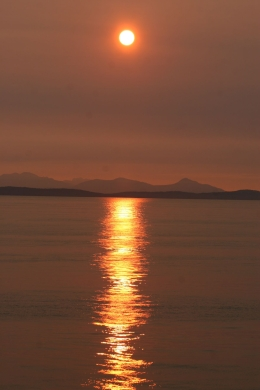 This wonderful sunset was captured on the ferry from Vancouver Island back to the mainland. Is was an amazing sight., Kym W - September 2010