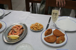 Shrimp, fried cod cakes, and green wine. , Barbara P - June 2016
