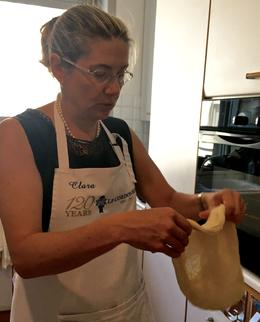 Clara demonstrates how to use gravity to shape pizza dough , Linda S - June 2017